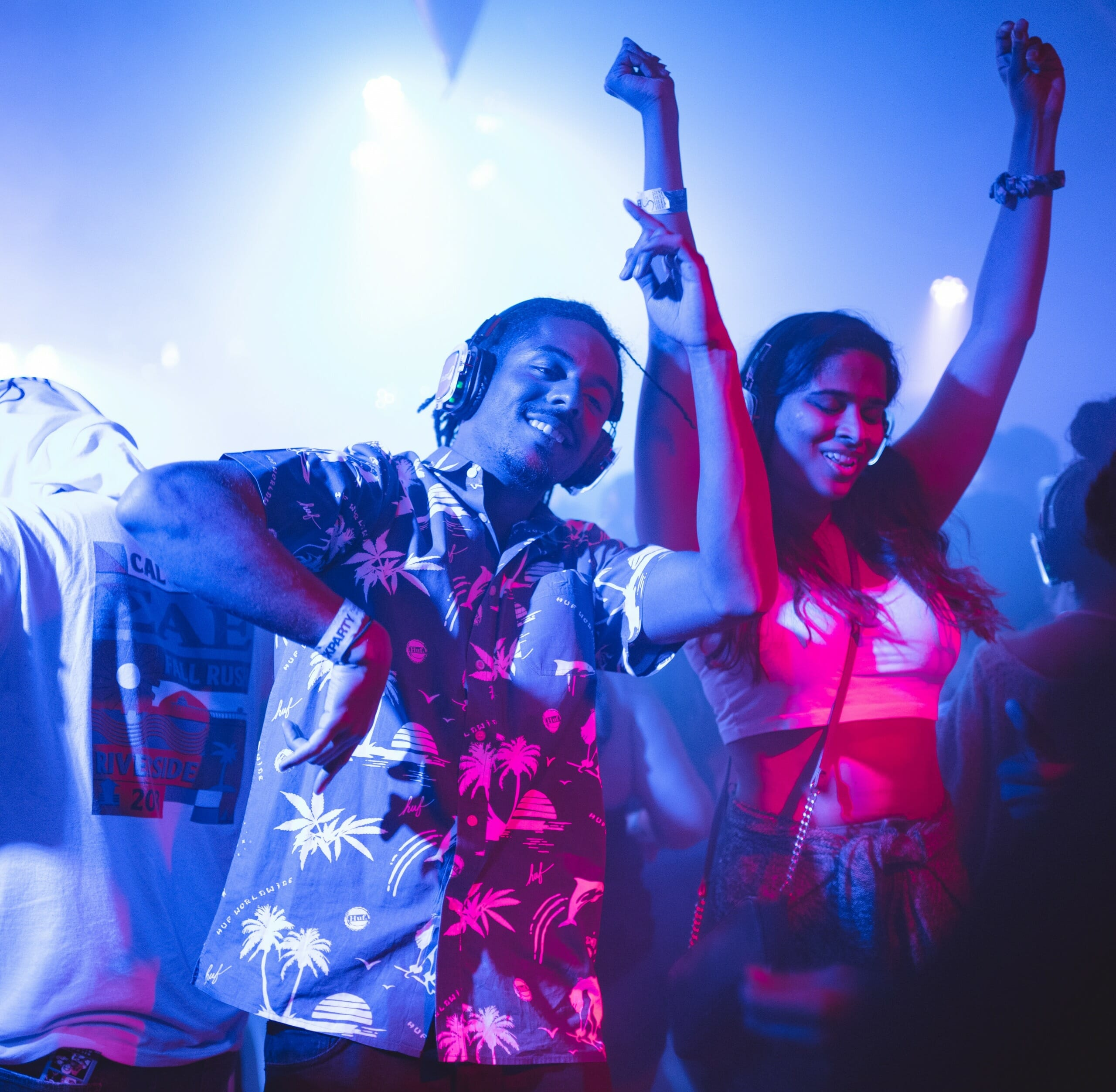 Party Started – DJ standing and dancing near smiling woman surrounded
